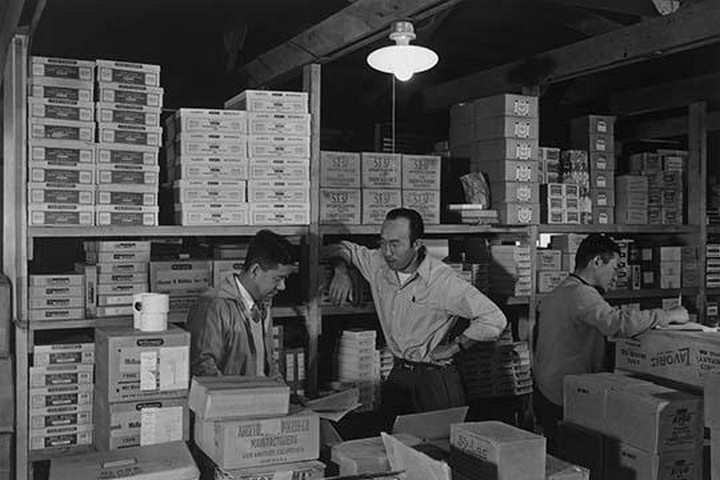 Warehouse, M. Ogi, manager; S. Sugimoto, manager of Co-op; Bunkichi Hayashi by Ansel Adams - Art Print