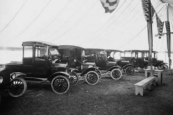 Automobiles on Display in Showroom Interior - Art Print