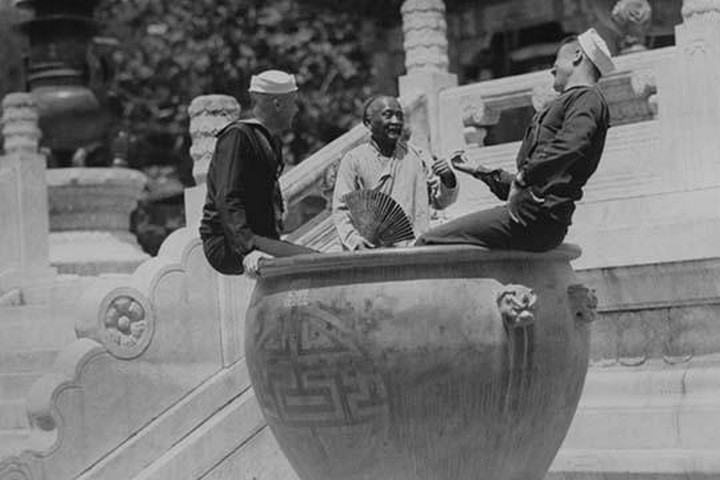U.S. Navy Sailors on Shore Leave in Beijing frolic in Giant Ceramic Pot with Guide - Art Print