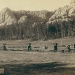 Full view of as train coming through the mountains in the West - Art Print