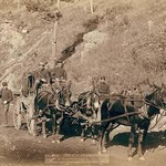 The U.S. Paymaster and Guards on Deadwood road to Ft. Meade by John C.H. Grabill - Art Print