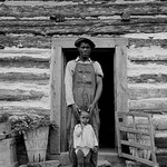 Young sharecropper and his first child by Dorothea Lange - Art Print