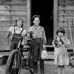 Beautiful Children with Bike and a Cat by Dorothea Lange - Art Print