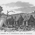 Abandoned Confederate log cabins at Manassas by Frank Leslie - Art Print