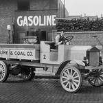 Grove Lime & Coal Company in front of a building sign that reads Gasoline - Art Print