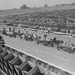 Auto racers at Speedway line up at starting line to begin the race. - Art Print