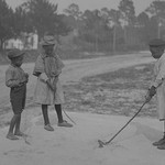 African American Children pretend to play golf on country road - Art Print
