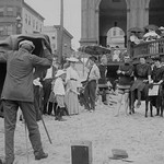 Photographer taking picture of group with donkey at crowded beach, Atlantic City, N.J. - Art Print