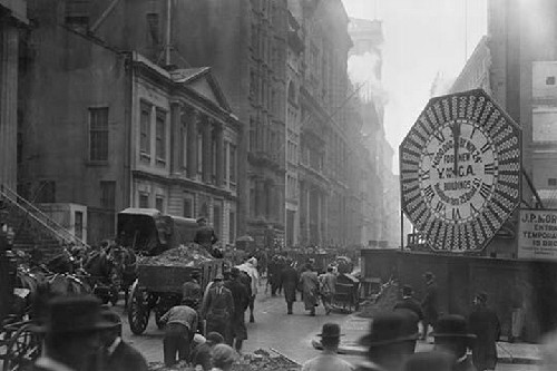 Wagons trundle along Manhattan Streets past a YMCA clock sign - Art Print
