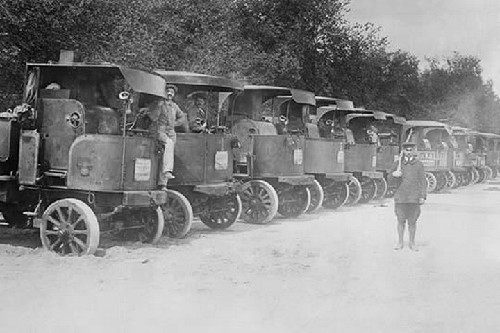 A Fleet of Trucks each with its own Driver is arrayed and ready to transport troops. - Art Print